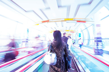 moving escalator with people