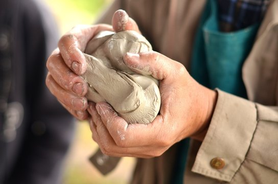 Person working with clay