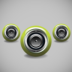 Three modern green loudspeakers