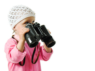 girl in  pink dress with a pair of binoculars