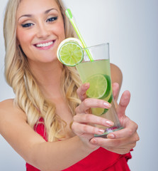 Young woman drinking lemonade, FOCUS ON  DRINK