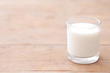 Milk on wood table background