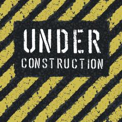 Under construction message on asphalt background. Vector, EPS8