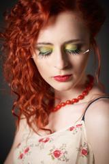Fashion shot of an beautiful red hair gir