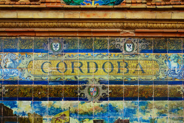 Cordoba sign over a mosaic wall