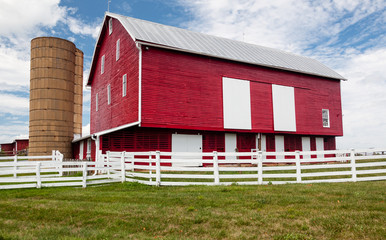 Traditional US red painted barn on farm
