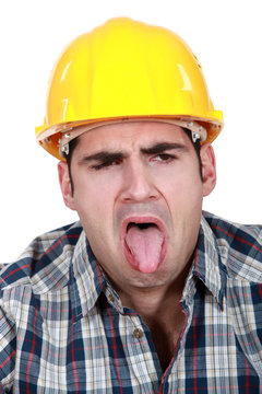 Construction worker with his tongue out