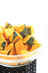 cut pumpkin in glass bowl for food preparation image