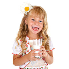 Little smiling girl holding a glass of milk isolated on white