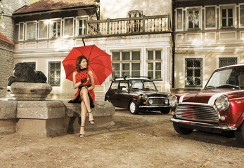 Foto op Textielframe Rood, zwart, wit A vintage fashion shoot with a young woman holding an umbrella