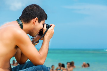 Hispanic photographer at the beach