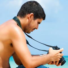 Amateur hispanic photographer at the beach