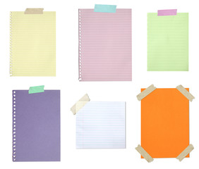 Collection of blank paper stuck with tape isolated on white