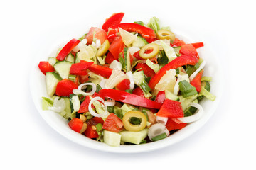 Healthy food. Fresh vegetable salad on a white background.