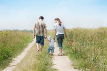 Happy family in a field