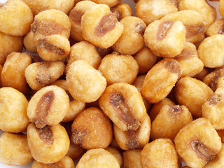 Close up of fried, salted corn seeds.