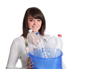 Girl sorting plastic bottles for garbage