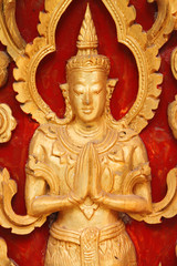 Carving on wooden door of Thai temple
