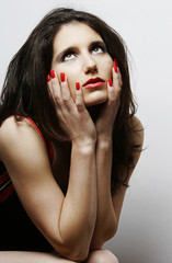 Beautiful woman with red lips and nails