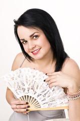 A beautiful woman with a fan .