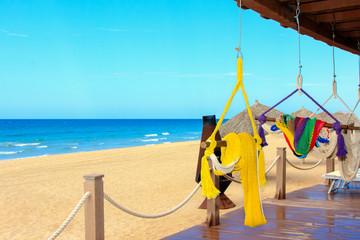 Sand sun ocean and hammocks