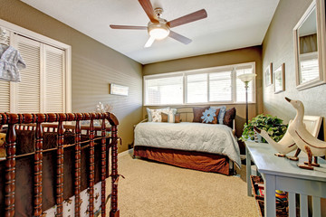 Kids nursery interior with blue and brown bed.