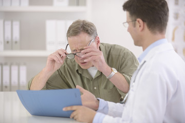 Doctor showing results to myopic patient