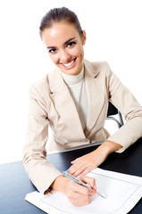Businesswoman writing at office, isolated