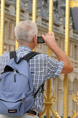 France, tourist take photographs of Versailles castle