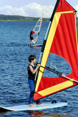 Young boy studies to go for a drive on windsurfing