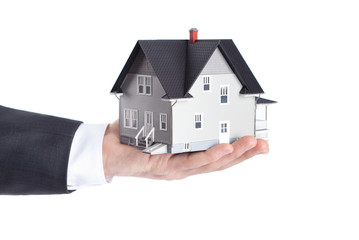 Realty concept - hand holding house model