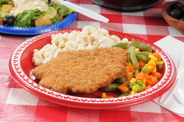 Chicken fried steak on a picnic table