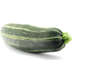 Single green squash isolated over white