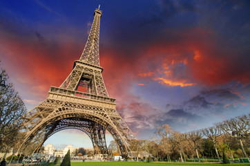 Wall Mural - Eiffel Tower in Paris under a thunder-charged sky