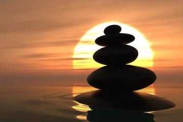 Fototapete - Zen pebbles stacked in sunset