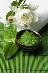 bath salt and gardenia flower on towel with essential oi