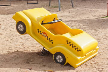 yellow car toy in park