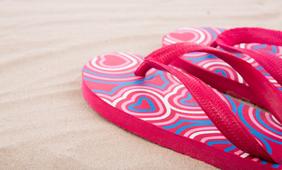 Flipflops on sand beach