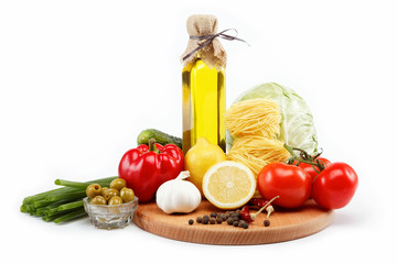 set fresh vegetables with olive oil isolated on white background