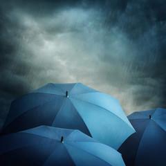 Dark clouds and umbrellas