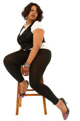 Beautiful Black Plus Sized Woman sitting on stool