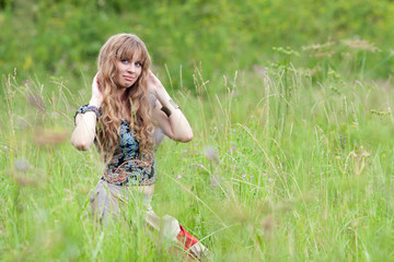 The girl of hippie costs in a grass