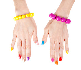 Women's hands with a fashionable multi-colored nail polish with