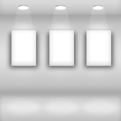 Empty frames on bright wall in gallery interior