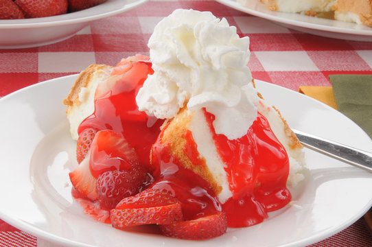 Closeup of strawberry shortcake on a picnic table