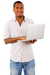 Smiling black man with laptop, isolated on white