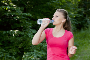 athletic girl with a bottle of water