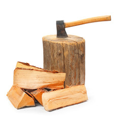 Cut logs fire wood and old axe. Renewable resource of a energy.