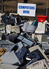 Computers and monitors piled up for recycling