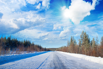 Winter road in deep forest.